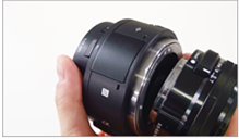 Image depicting attachment of the lens to the ILCE-QX1