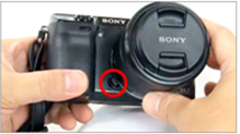 Image indicating the location of the lens release button on the camera