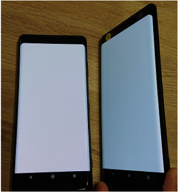 two OLED mobile devices. One on a flat surface and the other at an angle showing the blueish tone
