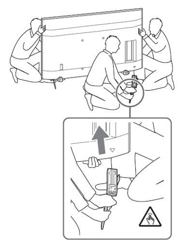 Image for removing the Table-Top Stand from the TV with 3 persons