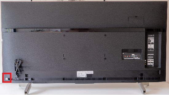 Back of the TV - model and serial number sticker (left corner)