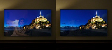 Images of a hilltop town at night on separate TV screens, showing the benefit of X-Anti Reflection.