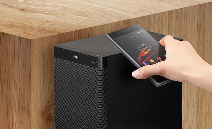 Smartphone wirelessly connecting to subwoofer