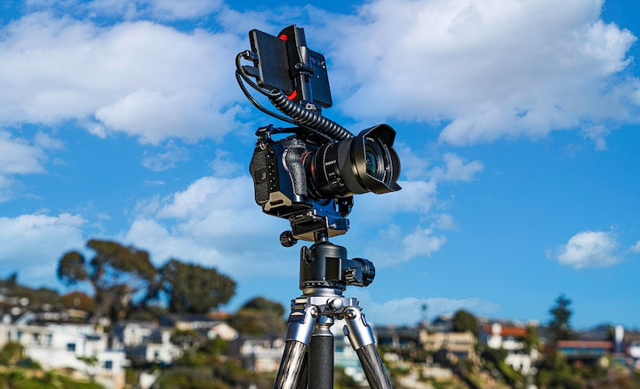 Location image showing the Xperia PRO mounted on a camera on a tripod.