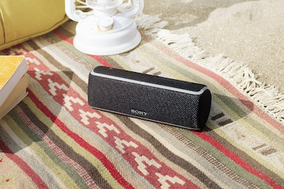SRS-XB21 speaker product shot beach setting