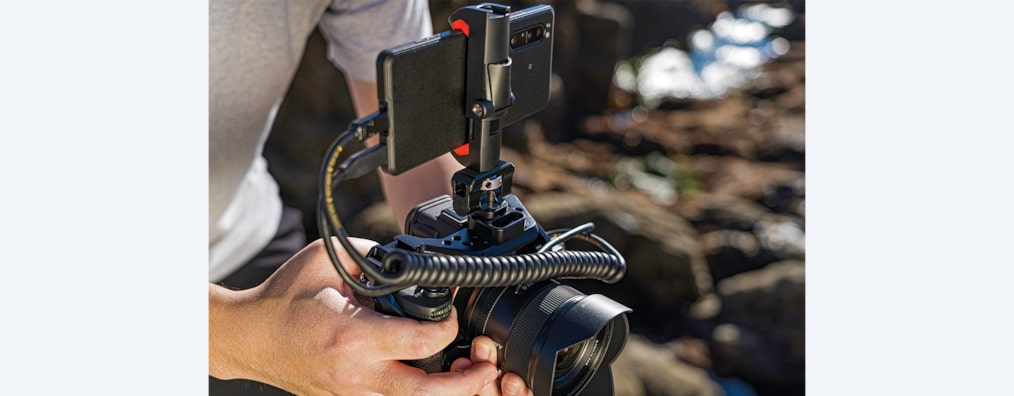 Man using Xperia PRO mounted on a camera