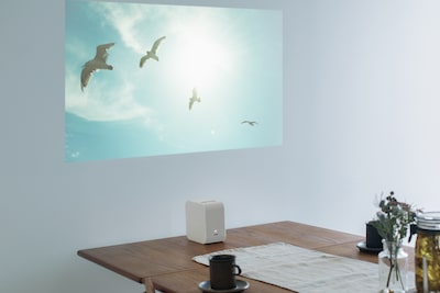 Portable Ultra Short Throw Projector on table
